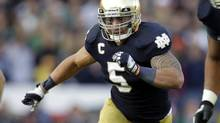 FILE - In this Oct. 20, 2012, file photo, Notre Dame linebacker Manti Te'o chases the action during the second half of an NCAA college football game against the BYU in South Bend, Ind. (Michael Conroy/AP)