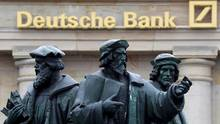 A statue is pictured next to the logo of Germany's Deutsche Bank in Frankfurt, Germany, September 30, 2016. (KAI PFAFFENBACH/REUTERS)