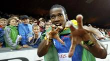 Jamaica's Yohan Blake celebrates as he won the men's 100m race during the Weltklasse Diamond League meeting in Zurich August 30, 2012. (PASCAL LAUENER/REUTERS)