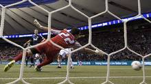 Vancouver Whitecaps' Darren Mattocks's shot goes past Edmonton FC goalkeeper David Monsalve during the second half of Amway Canadian Championship semi-final soccer action in Vancouver on May 9, 2012. (Jonathan Hayward/The Canadian Press/Jonathan Hayward/The Canadian Press)
