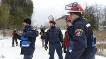 Members of the Ontario Volunteer Emergency Response Team look for Jeffrey Boucher in the woods near Taunton Road and Brock Street on Jan. 15, 2014. (Fred Lum/The Globe and Mail)