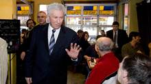 Bloc Quebecois Leader Gilles Duceppe waves to a supporter during a visit to a restaurant in Montreal onTuesday March 29. (Graham Hughes/The Canadian Press)