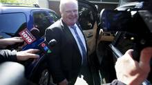 Toronto Mayor Rob Ford briefly speaks to the media responding to allegations made by a U.S. website that he smokes crack cocaine, before getting into his SUV at his Etobicoke home in Toronto on Friday, May 17, 2013. (Michelle Siu For The Globe and Mail)