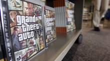 A Best Buy customer rushes in to purchase a copy of the game Grand Theft Auto IV in 2008. (Paul Sakuma/AP)