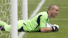 Toronto FC goalkeeper Stefan Frei reacts as he stops the ball just short of the line during the second half of an MLS soccer game against Philadelphia Union, Saturday May 28, 2011, in Toronto. (Chris Young/THE CANADIAN PRESS)