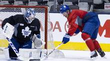 Toronto Maple Leafs goalie James Reime blocks a shot from Leafs Carter Ashton during practice (Deborah Baic/The Globe and Mail)