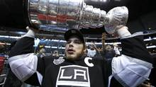Los Angeles Kings' Dustin Brown holds up the Stanley Cup after his team defeated the New Jersey Devils in Game 6 of the NHL Stanley Cup hockey final in Los Angeles, June 11, 2012. (Lucy Nicholson/REUTERS)