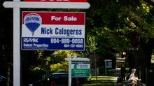 For sale signs sit on the lawns of houses in Vancouver's Kitsilano neighbourhood. (DARRYL DYCK For The Globe and Mail)