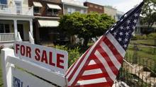 A U.S. flag decorates a for-sale sign at a home in the Capitol Hill neighborhood of Washington, in this file photo. (JONATHAN ERNST/Reuters)
