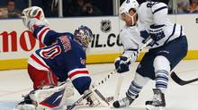 New York Rangers' goalie Henrik Lundqvist makes a save on Toronto Maple Leafs' Phil Kessel during the second period of their NHL hockey game at Madison Square Garden in New York, October 27, 2011. (Reuters)