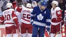 Toronto Maple Leafs left winger Joffrey Lupul skates off the ice as the Detroit Red Wings celebrate after their 4-2 win in NHL action in Toronto on Saturday, March 29, 2014. (CP)