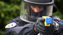A policeman conducts a demonstration of a Taser electroshock weapon in The Netherlands on March 27, 2009. (Robin Utrecht/ AFP/Getty Images/Robin Utrecht/ AFP/Getty Images)