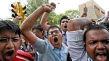 Students shout slogans during a protest against the reservation of college places for lower castes in New Delhi. (Adnan Abidi / Reuters/Adnan Abidi / Reuters)