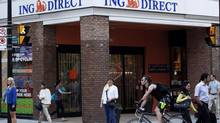 People walk by an ING Direct cafe in Toronto following the announcement on Wedneday that ING Bank of Canada will be acquired by Bank of Nova Scotia. (Michelle Siu/THE CANADIAN PRESS)