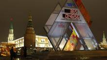 People look at a countdown clock to the 2014 winter Olympics near the Kremlin, in the centre of Moscow February 7, 2013. Towns held ceremonies across Russia on Thursday to mark 365 days remaining until the start of the 2014 winter Olympics in the Black Sea resort of Sochi. (MIKHAIL VOSKRESENSKY/REUTERS)