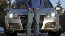 Calgarian Paul Kenney with his 2007 VW GTI – he'd much rather own a Scirocco. (Chris Bolin For The Globe and Mail)