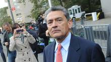 Rajat Gupta exits Manhattan federal court in New York in October following arraignment. The insider trading trial for the former McKinsey boss and Goldman Sachs director starts Monday in New York. (Louis Lanzano/Associated Press/Louis Lanzano/Associated Press)