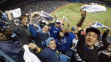 Toronto Blue Jays fans wave their rally towels. (MIKE CASSESE/Mike Cassese/Reuters)