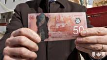 A new $50 dollar note has become the first plastic bill Canadians can get through bank machines.