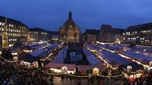 In this picture taken with a fish-eye lens, the Church of Our Lady is photographed during the traditional opening of the world-famous Christmas market at the Old Town in Nuremberg, southern Germany, on Nov. 29, 2013. (Matthias Schrader/AP)