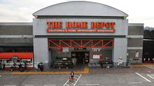 A customer leaves a Home Depot store on Nov. 18, 2014 in Colma, Calif. (Justin Sullivan/Getty Images)