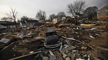 A car and houses damaged by the storm surge of Hurricane Sandy, one month after the disaster at Union Beach, N.J. (Eduardo Munoz/Reuters)