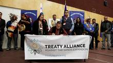 Grand Chief Stewart Phillip signs the Treaty Alliance Against Tar Sands Expansion with other First Nations leaders during an announcement on oil sands pipelines. (BEN NELMS)