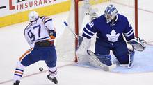 Edmonton Oiler Conor McDavid takes the puck to the net Toronto Maple Leaf netminder Frederik Andersen stands his ground during an NHL game at the Air Canada Centre on Nov. 1, 2016. (Fred Lum/The Globe and Mail)