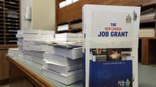 Copies of the 2013 budget are seen in the parliamentary press room on Parliament Hill on March 21, 2013. (DAVE CHAN FOR THE GLOBE AND MAIL)