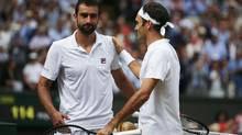 Marin Cilic of Croatia (left) and Roger Federer shake hands after the Wimbledon single men's final on Sunday in London. (Daniel leal-olivas/Getty Images)