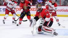 Ottawa Senators' Craig Anderson deflects a shot against the Carolina Hurricanes in Ottawa on Tuesday, Nov. 1, 2016. (Sean Kilpatrick/THE CANADIAN PRESS)