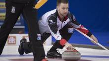 Canada skip Brad Gushue makes a shot during the gold-medal game against Sweden at the men's world curling championships in Edmonton on April 9, 2017. (Jonathan Hayward/The Canadian Press)