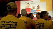Supporters of Liberal leader Dalton McGuinty watch the Ontario election results at Liberal election headquarters in Ottawa, Thursday October 6, 2011. (THE CANADIAN PRESS/Sean Kilpatrick/THE CANADIAN PRESS/Sean Kilpatrick)