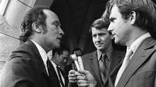 Reporters Tim Ralfe, right, and Peter Reilly, centre, question Prime Minister Pierre Trudeau on the steps of Parliament Hill about the FLQ crisis and the invocation of the War Measures Act. (PETER BREGG/Peter Bregg/CP)