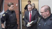 Dennis Oland is taken from the Court of Appeal in Fredericton on Oct. 18, 2016. (Andrew Vaughan/THE CANADIAN PRESS)