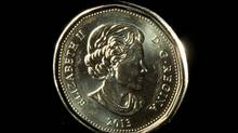 A loonie is pictured on Dec. 31, 2013. (Jonathan Hayward/The Canadian Press)