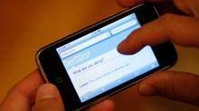 A Twitter page is displayed on an Apple iPhone in Los Angeles October 13, 2009. (MARIO ANZUONI)