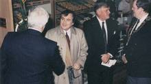 Undated. Jim Charade in beige coat, Ron Joyce, second from right.