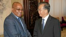 South African President Jacob Zuma (L) shakes hands with Chinese Premier Wen Jiabao at the Zhongnanhai leaders' compound in Beijing on August 25, 2010. (ADRIAN BRADSHAW/AFP/Getty Images)
