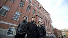 Partners Florent Moser (L), Ali Lakhdari (C) and David Lafrance of Demonfort, a development and construction firm, stand outside les Soeurs missionnaires de l'Immaculée-Conception, the convent they plan to convert to condos in Montreal, December 8, 2015. (Christinne Muschi for The Globe and Mail)