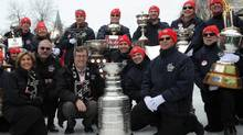 Ottawa Mayor Jim Watson holds the Stanley Cup along with Ottawa Senators head coach Paul MacLean, second from left, as the cups of the NHL are seen on the Rideau Canal Skateway during the opening ceremonies to the All-Star weekend in Ottawa on Thursday, January 26, 2012. The Stanley Cup was last seen on the Rideau Canal in 1905. (Sean Kilpatrick/THE CANADIAN PRESS)