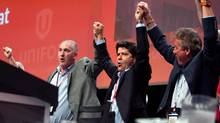 Jerry Dias, centre, celebrates after being declared the first president of the new Unifor union at the Unifor founding convention in Toronto, Saturday, August 31, 2013. (Galit Rodan/THE CANADIAN PRESS)
