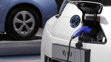 Toyota IQ electric car. But the world is filled with more than 700 million cars and that number will soon grow to a billion or more. (Christian Hartmann/REUTERS)