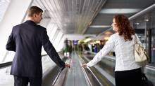 Man and woman walking on the escalator (Sergey Ryzhov)