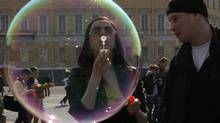 A participant takes part in a soap bubble festival in the Palace Square in St.Petersburg April 22, 2012. (ALEXANDER DEMIANCHUK/ALEXANDER DEMIANCHUK/REUTERS)