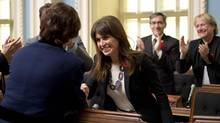 Véronique Hivon, Quebec's Minister for Social Services and Youth Protection, is congratulated after voting for legislation that would regulate health care for people at the end of their life on Oct. 29, 2013, at the National Assembly in Quebec City. (JACQUES BOISSINOT/THE CANADIAN PRESS)