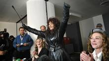 Sex worker advocate Terri-Jean Bedford raises her arms in victory during a press conference in Toronto, Ont. Monday, March 26, 2012., after Ontario's top court ruled in favour of legalizing brothels. (Kevin Van Paassen/The Globe and Mail/Kevin Van Paassen/The Globe and Mail)