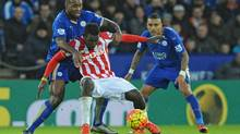 Leicester City's Wes Morgan, rear, holds back Stoke City's Mame Biram Diouf during an English Premier League soccer match on Jan. 23. (Rui Vieira/AP Photo)