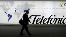 A visitor walks in front of Spanish communications company Telefonica's stand at the 3GSM World Congress in Barcelona February 15, 2007. (ALBERT GEA/REUTERS)