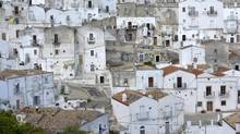 The mountaintop town of Monte Sant'Angelo is a labyrinth of sun-bleached homes built on steep streets. (Lili Okuyama)